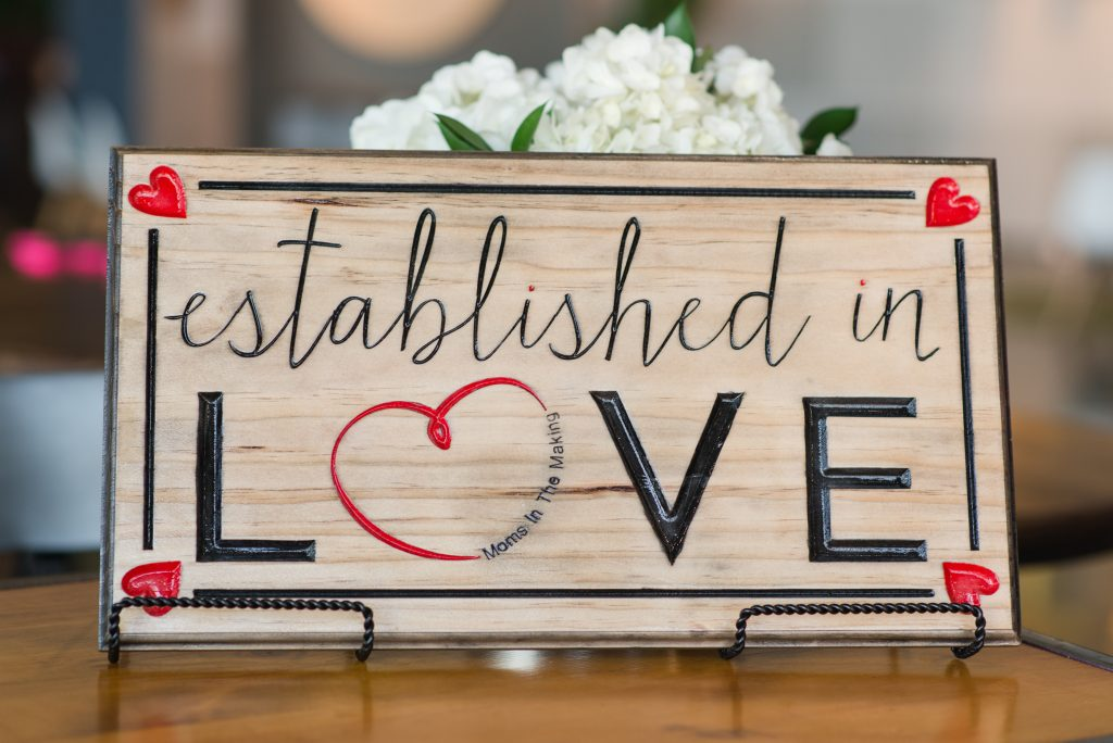 established in love wood making sign dallas Texas